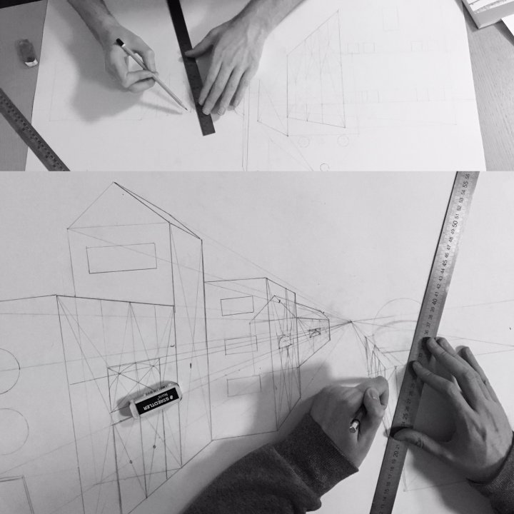 Students drawing urban architecture in perspective